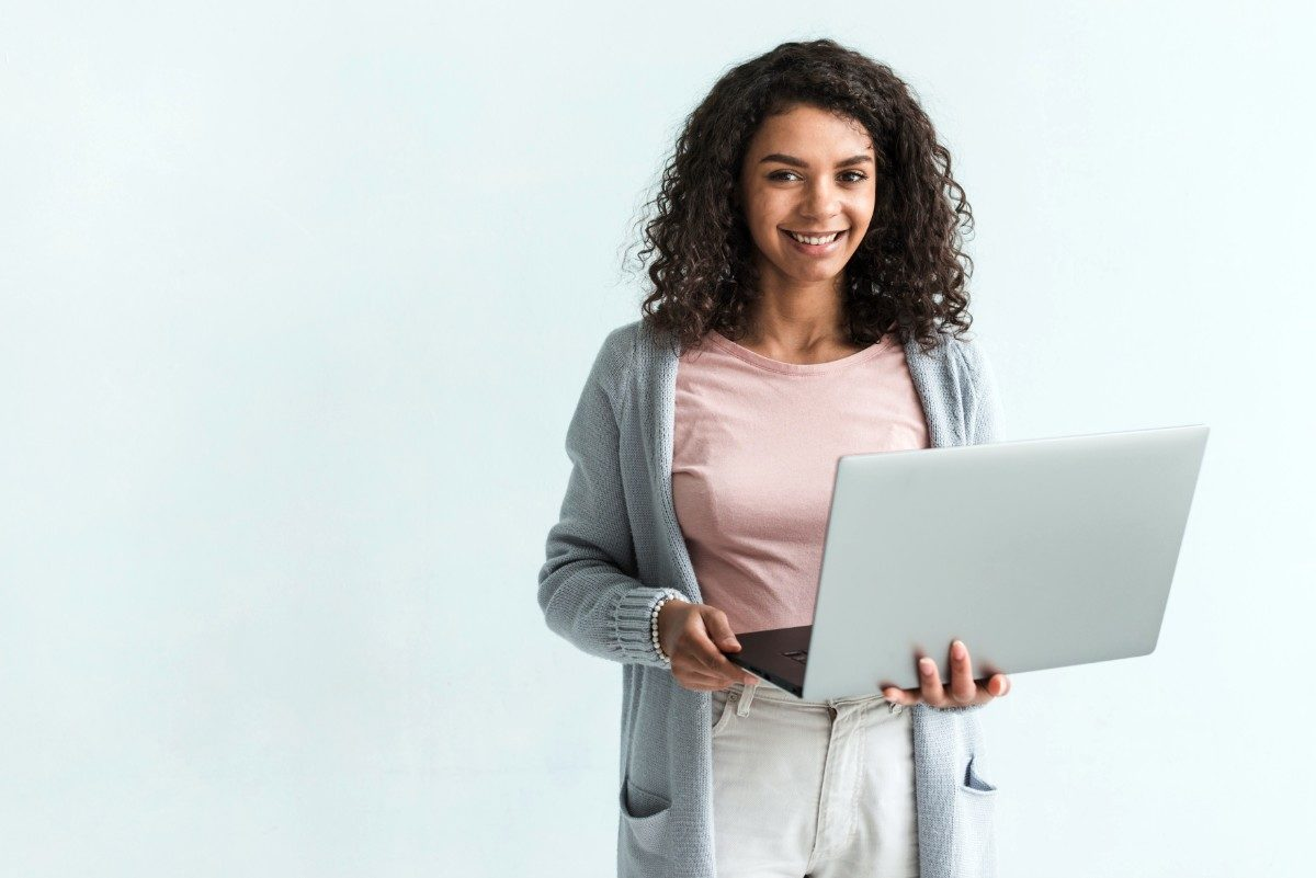 woman smiling while on computer