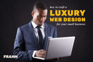 Luxury Web Design featured image – business professional in a suit looking at a laptop