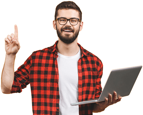 Man with beard and glasses wearing flannel, smiling, holding laptop pointing upward
