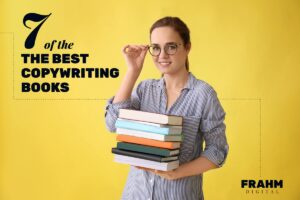 7 of the best copywriting books cover image: woman holding stack of books adjusting her glasses