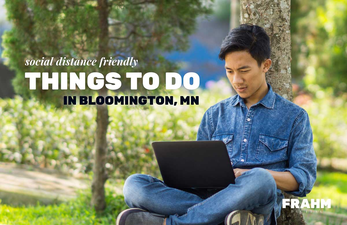 "man with laptop sitting outside against a northern pine tree: Text overlay reads ""Social Distance Friendly Things To Do in Bloomington, MN"""