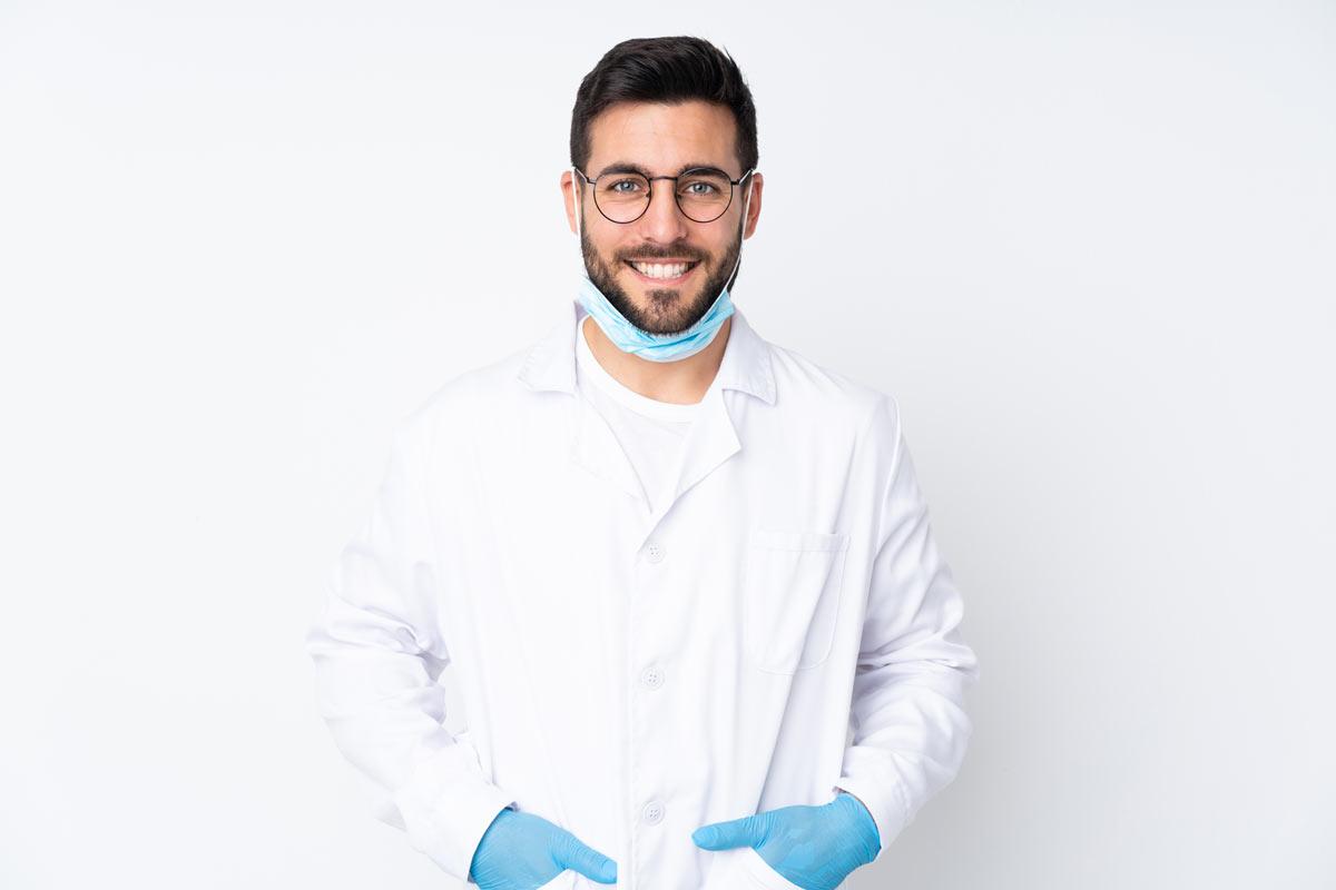dentist in scrubs smiling